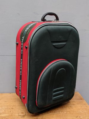 red and black large suitcase