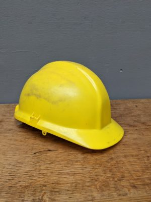 yellow plastic hard hat builders workmans